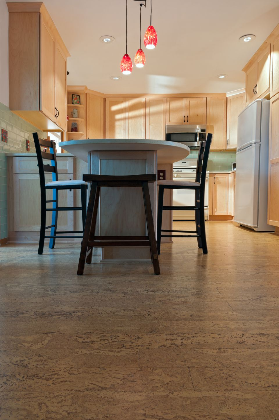 4 good and inexpensive kitchen flooring options eat in kitchen with light wood cabinets and cork flooring dailygadgetfo Gallery