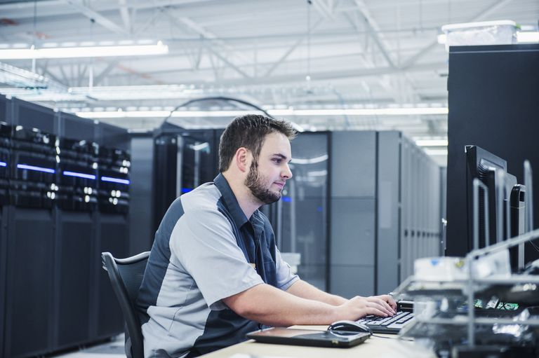 A network administrator working on a computer