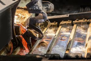 Close up of newly poured metal ingots at aluminum recycling plant