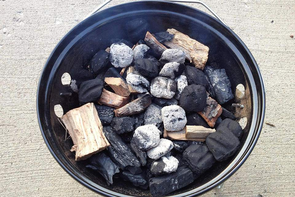 In the bottom of the Smokey Joe, unlit charcoal (lump and briquettes) and hickory wood.