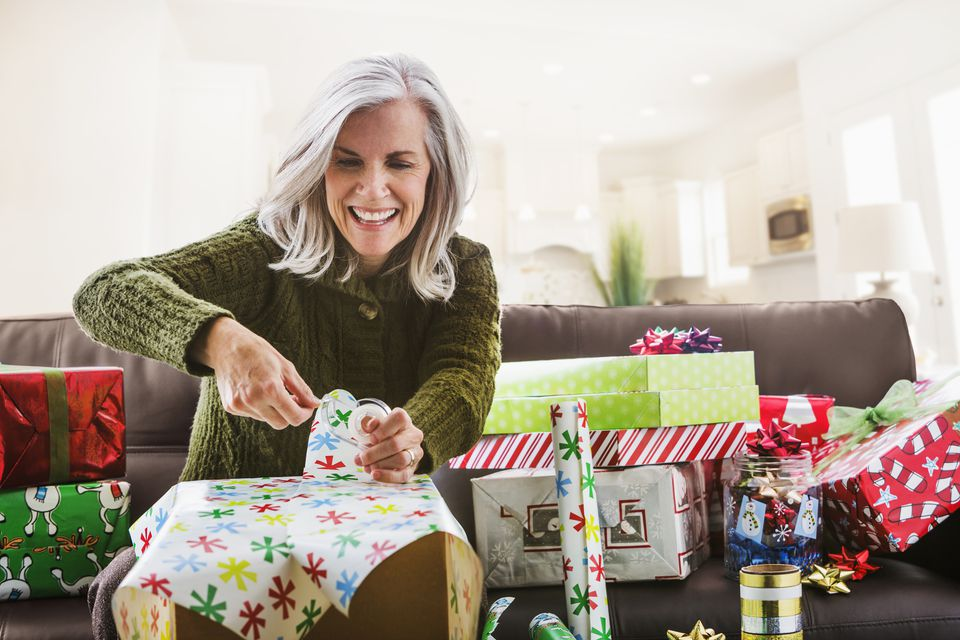 Caucasian woman wrapping Christmas gifts