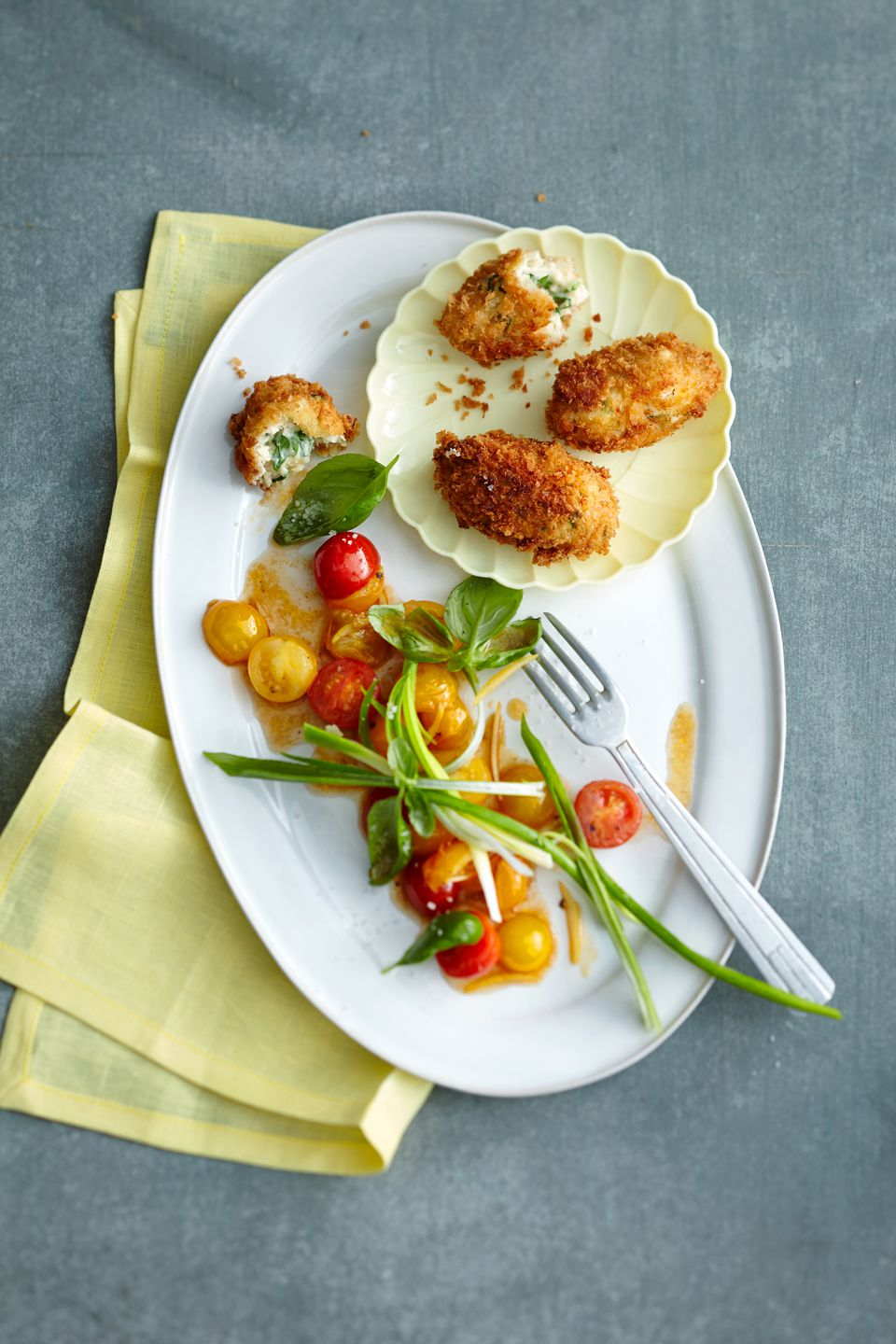Chicken croquettes with tomato salad