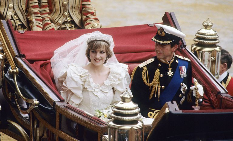 Princess Diana and Prince Charles sitting together in a carriage after their wedding.