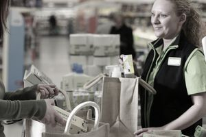 Cashier talking to a customer in a supermarket