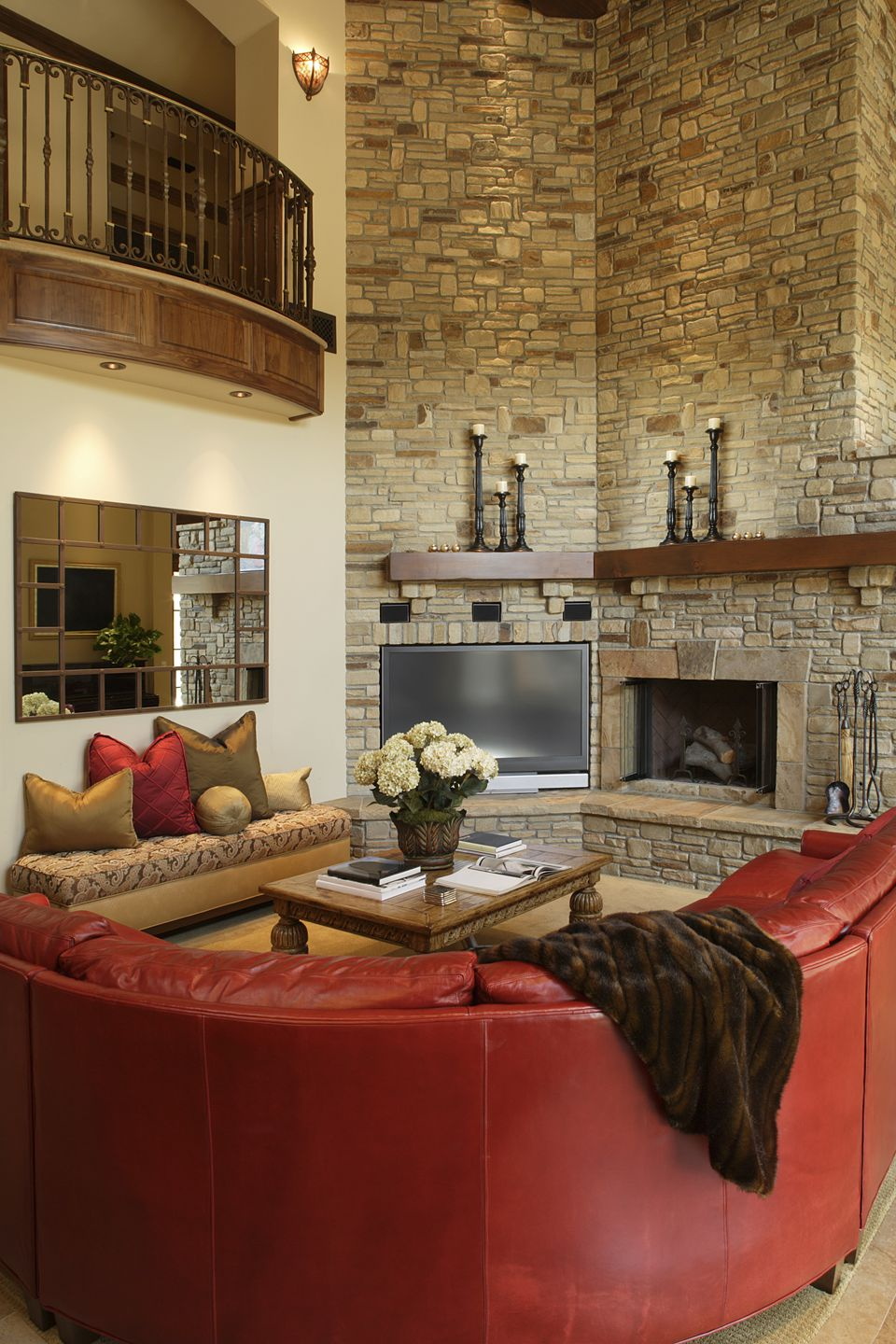 Red Leather Sofa in Living Room with Stone Fireplace