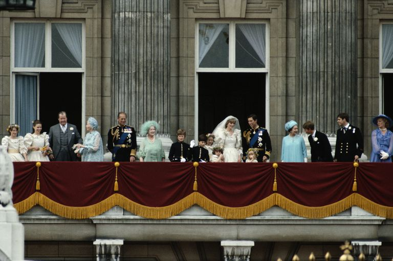 Royal family on balcony at Buckingham Palace after wedding.