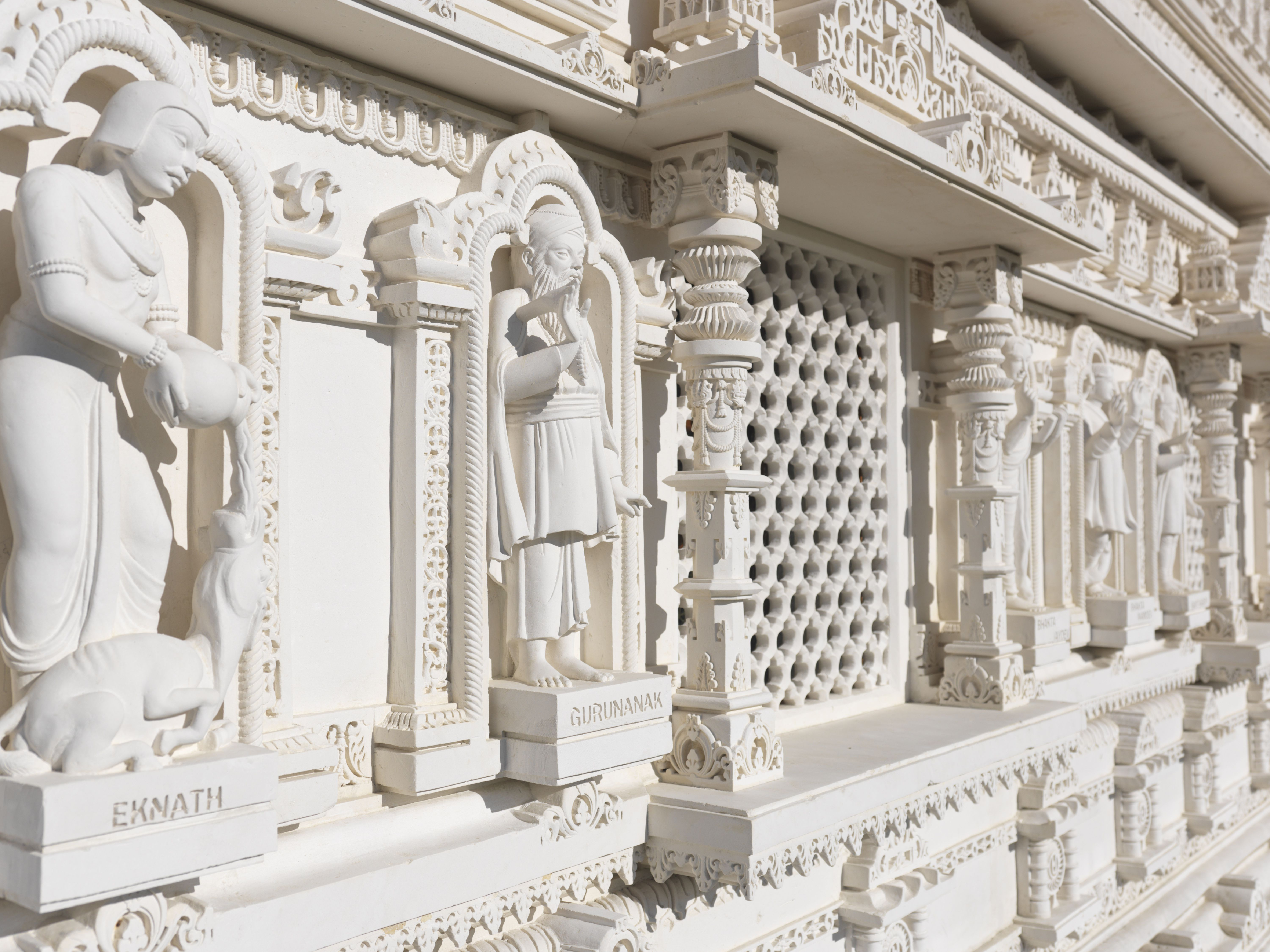 What is the origin of the swastika understanding the meaning of the nazi black sun symbol the swaminarayan mandir hand carved white marble hindu temple eknath and gurunanak carvings buycottarizona