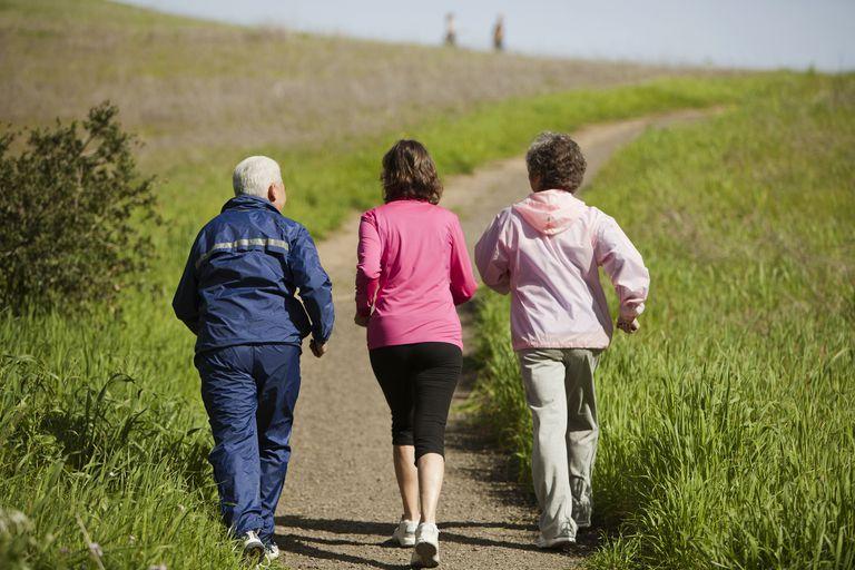 Three senior citizens walking