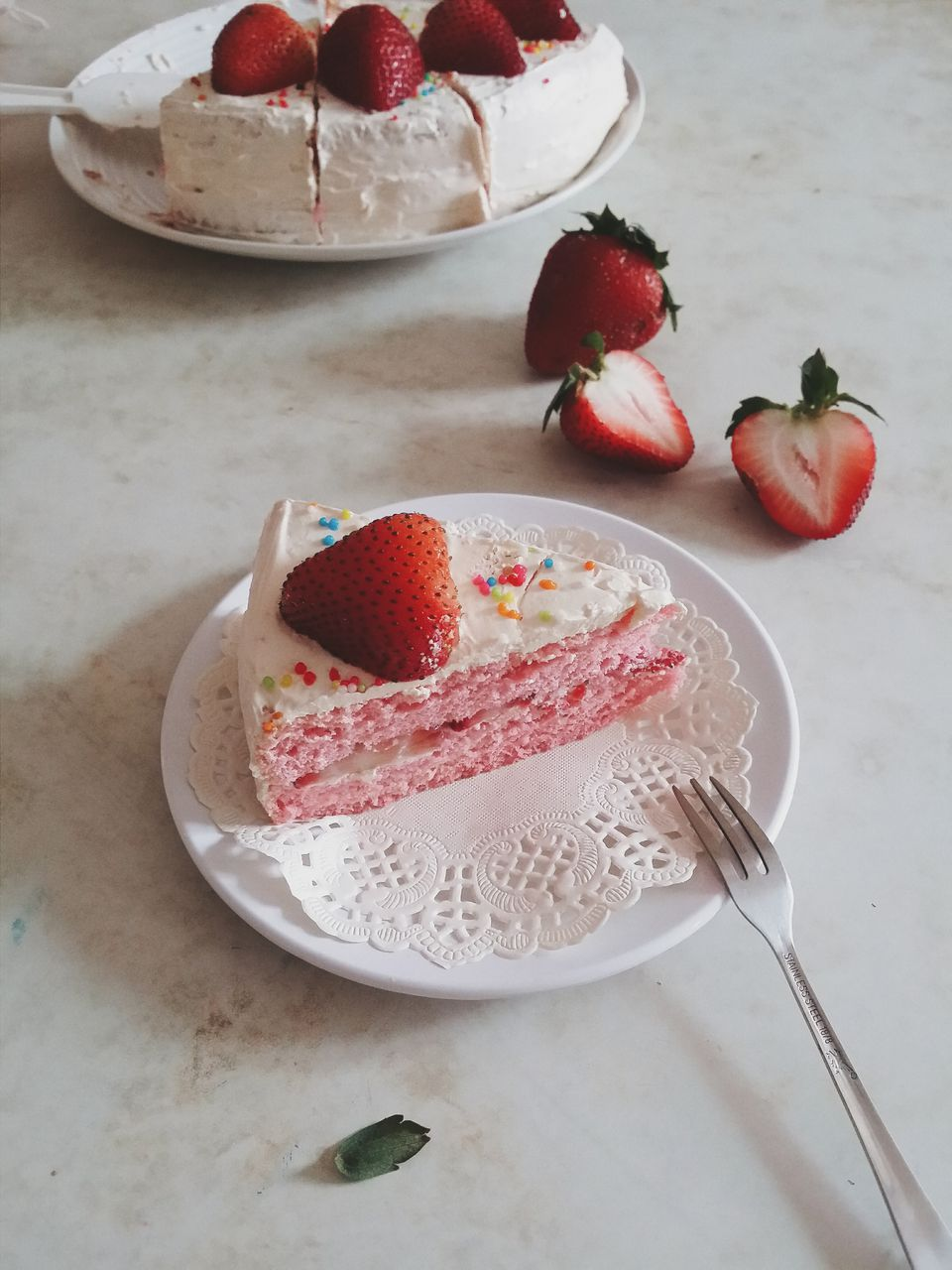 Close-Up Of Strawberry On Cake