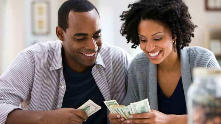 Man and woman sorting through their money