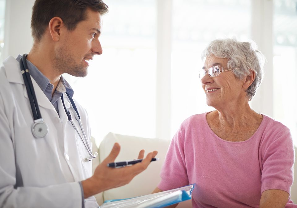 Shot of a male doctor explaining something to his senior patient