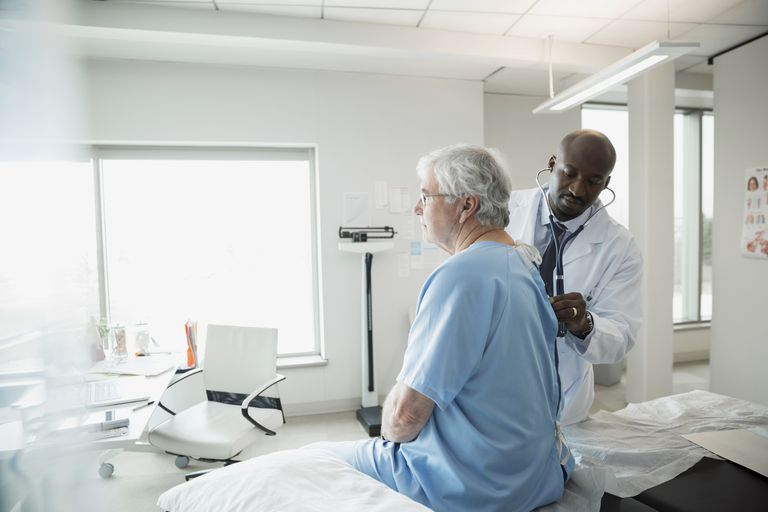 doctor examining senior man