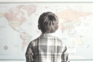 Child looking on map