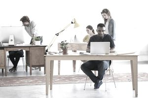 Shot of a group of young professionals working in an office.