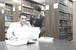 Lawyers doing research in law library