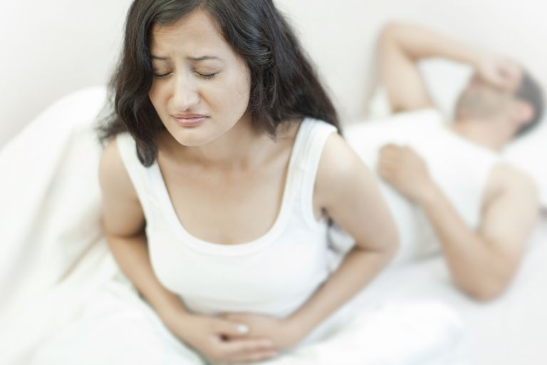 woman with stomach aches
