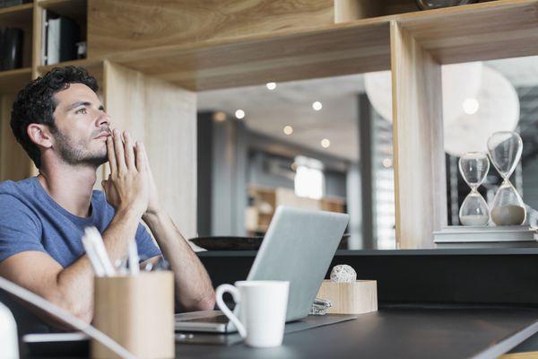 Man thinking at his laptop