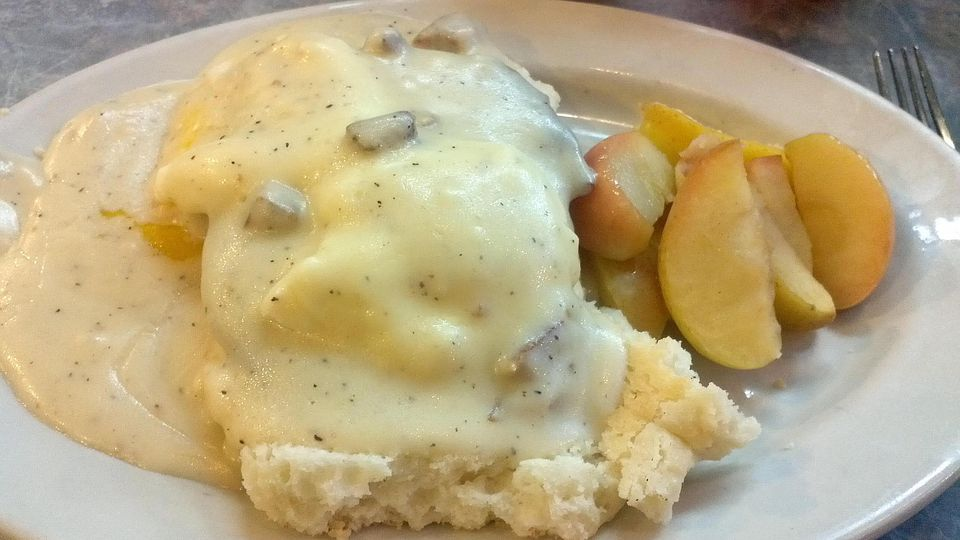 Poached eggs & sausage on a buttermilk biscuit. smothered in country sausage gravy on top