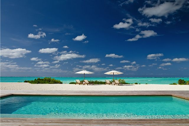 Infinity pool meets beach at Parrot Cay by COMO in the Caribbean