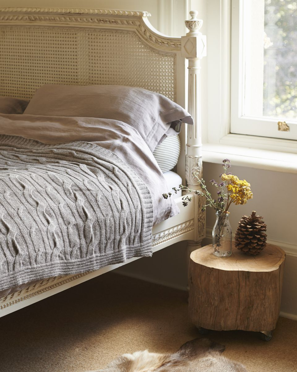 French country bed in rustic bedroom.