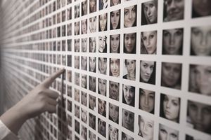 Pictures of women's faces on a wall