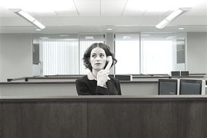 Receptionist business woman on phone