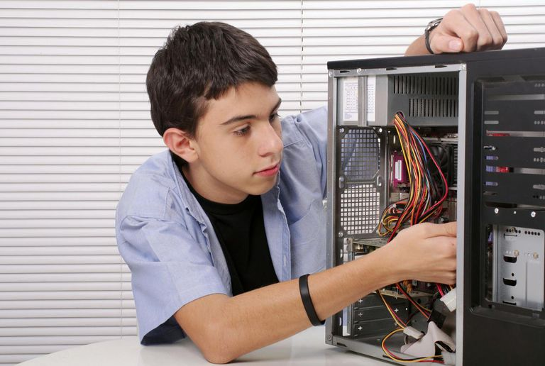 Picture of a teenager fixing a computer