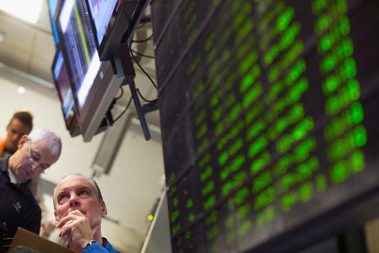men watching stocks at the stock exchange