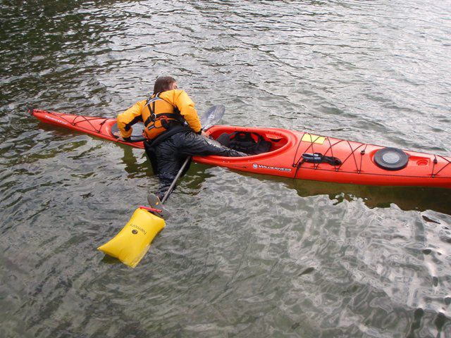 How to properly use a paddle float to get back into and bilge out a flipped kayak.