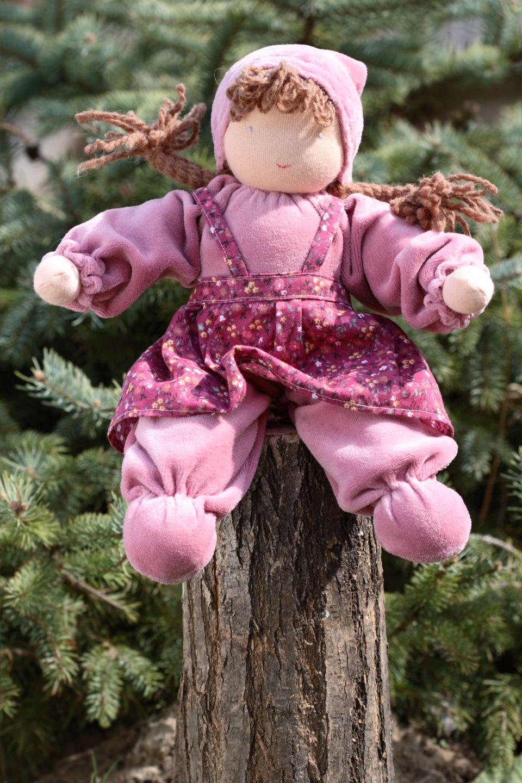 Doll Sitting on Trunk