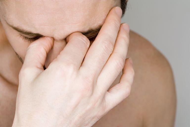 Man holding sinus area