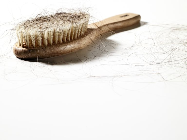 hairbrush with too much hair on it