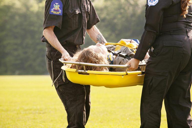 EMT Carrying Injured Woman on Gurney