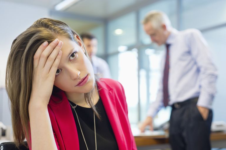 Sad, frustrated, beautiful woman at work