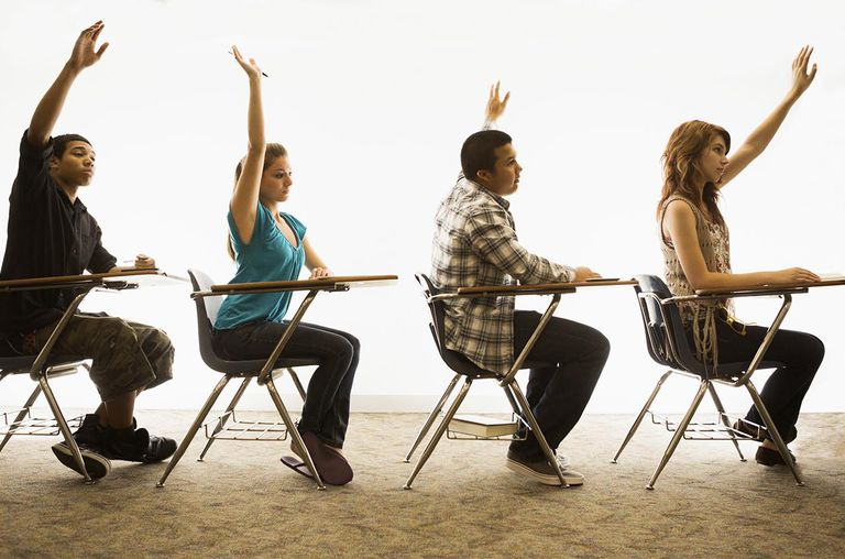 A group of collage students in a classroom.