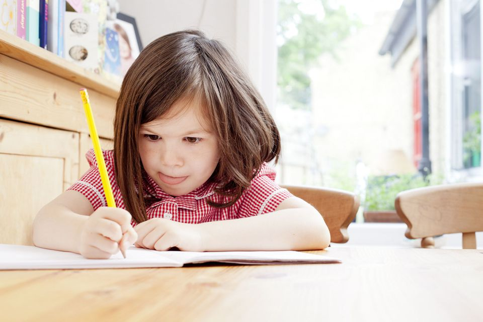 A picture of a child learning to write