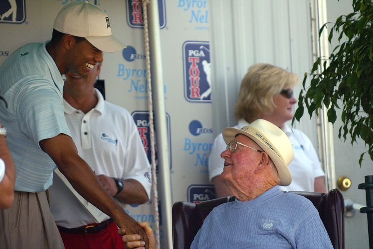 Tiger Woods greets Byron Nelson during the third round of the 2004 Byron Nelson Championship