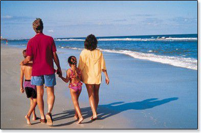 Family enjoying Melbourne Beach in Florida
