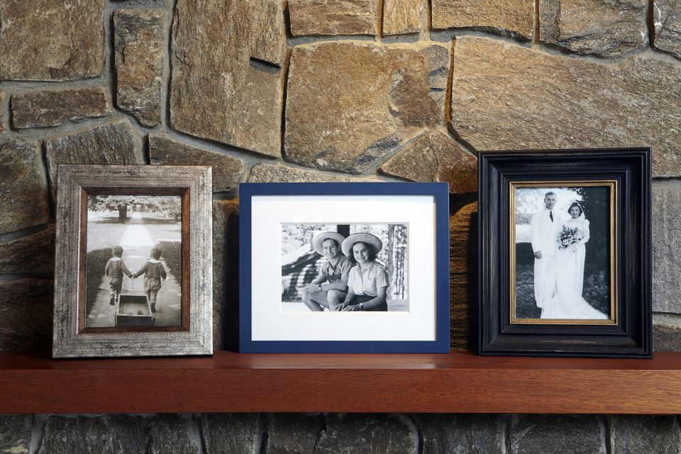 vintage family photos on mantle - Moving Picture Frames