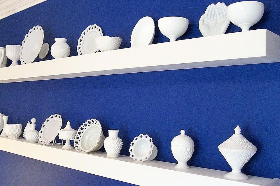 Display of a milk glass collection.