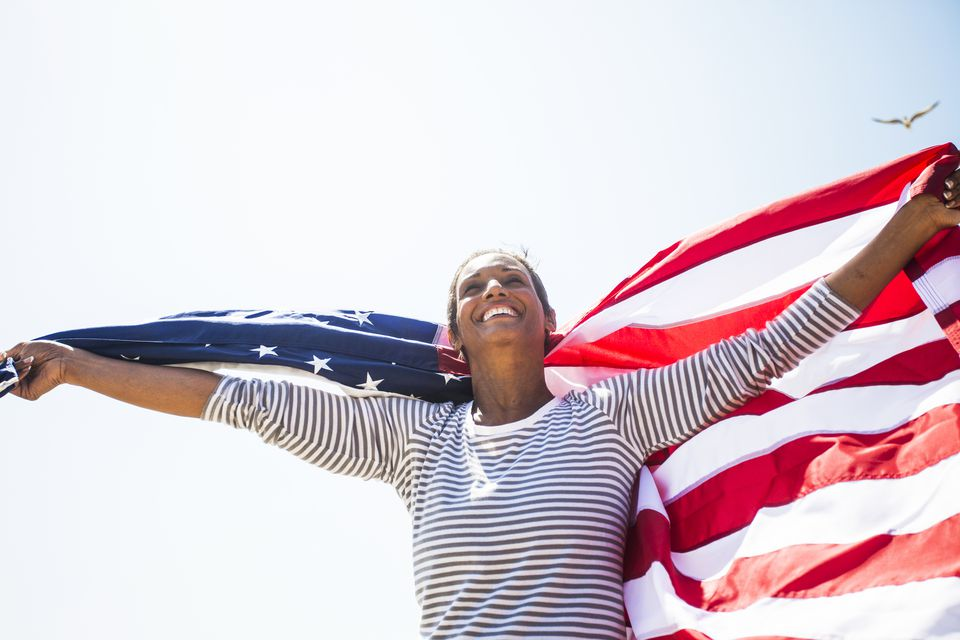 Woman carrying american flag