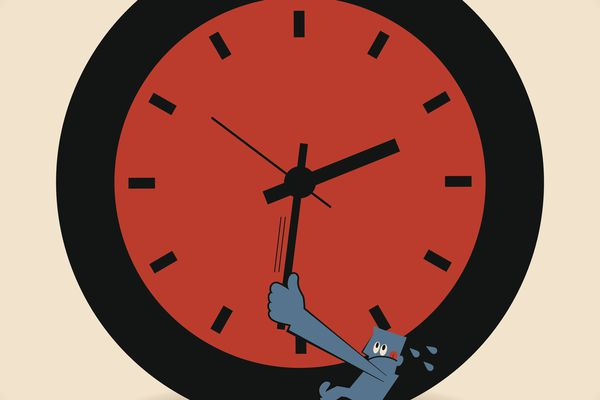 Person pulling back on the hands of a clock