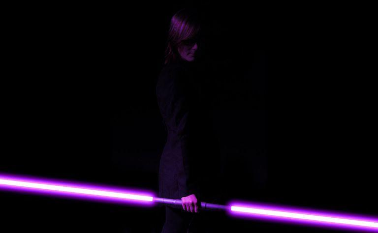 A Jedi Holds a Purple Lightsaber