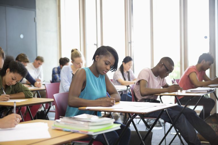University students taking exam at classroom