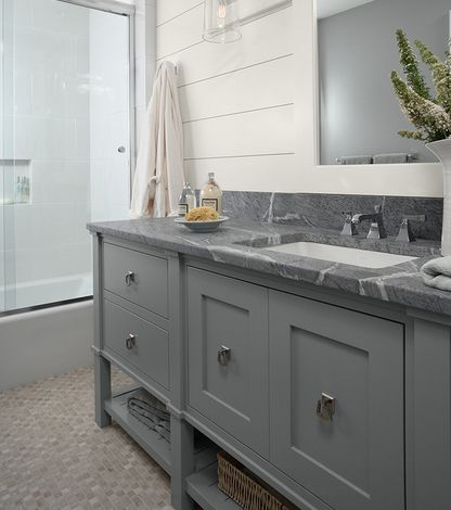 casa verde design gray cottage style bath with soap stone countertop
