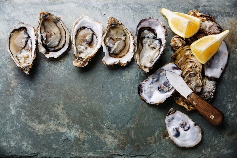 Open Oysters with lemon and knife