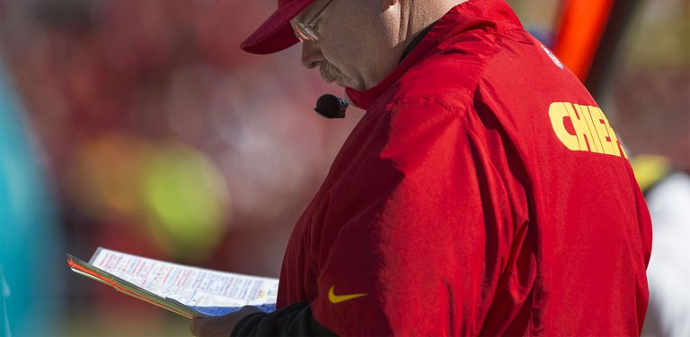Head coach Andy Reid of the Kansas City Chiefs looks at his playbook
