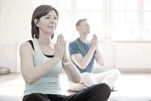Women doing yoga to stay health in retirement.