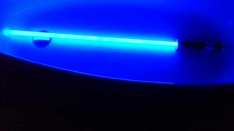Low Angle View Of Laser Sword In Bathroom