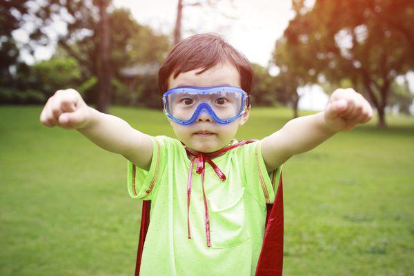 little boy playing dress up
